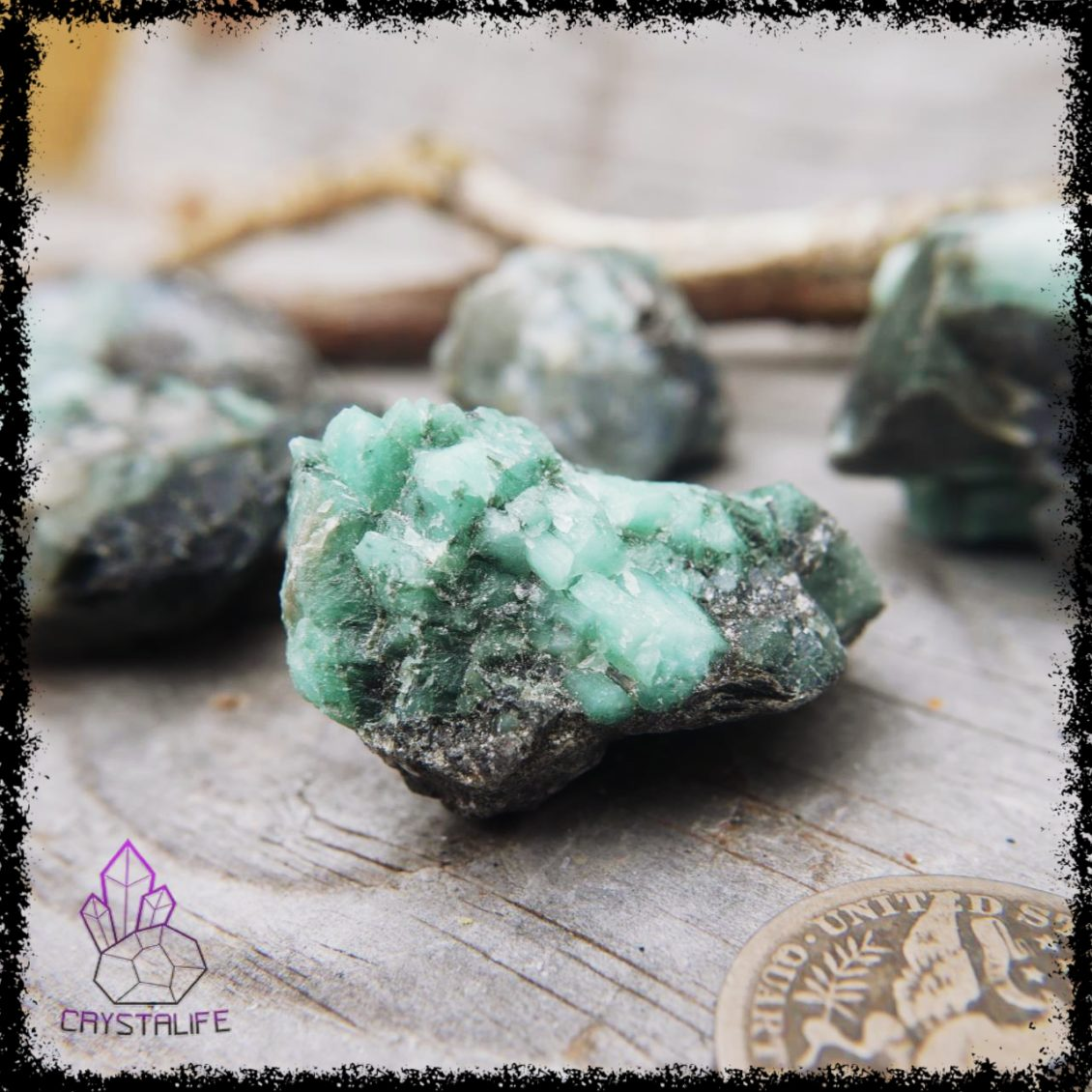 Rough emerald crystal on matrix. Healing stones and crystal jewelry in the holistic shop.