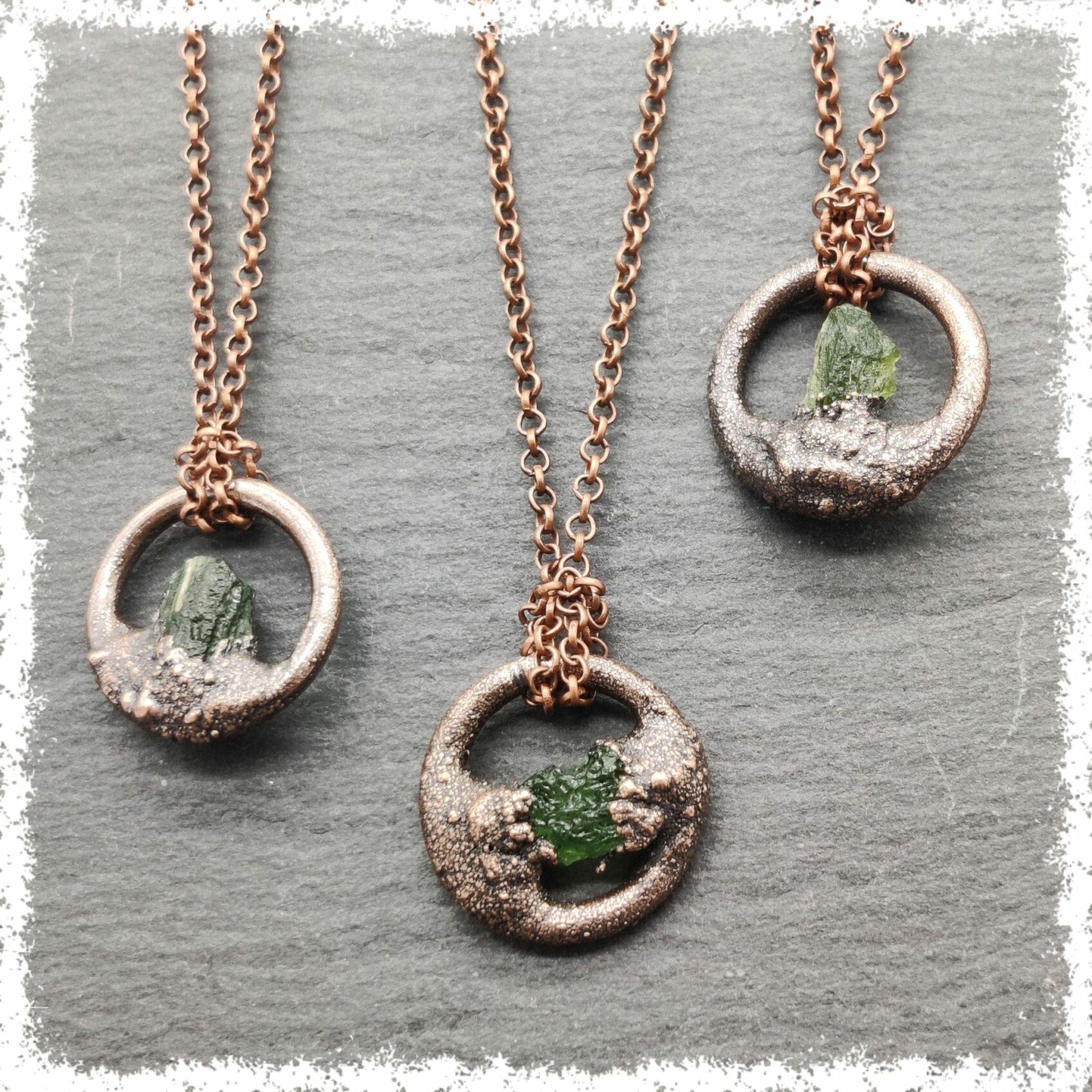 citrine gemstone in copper pendant on chain