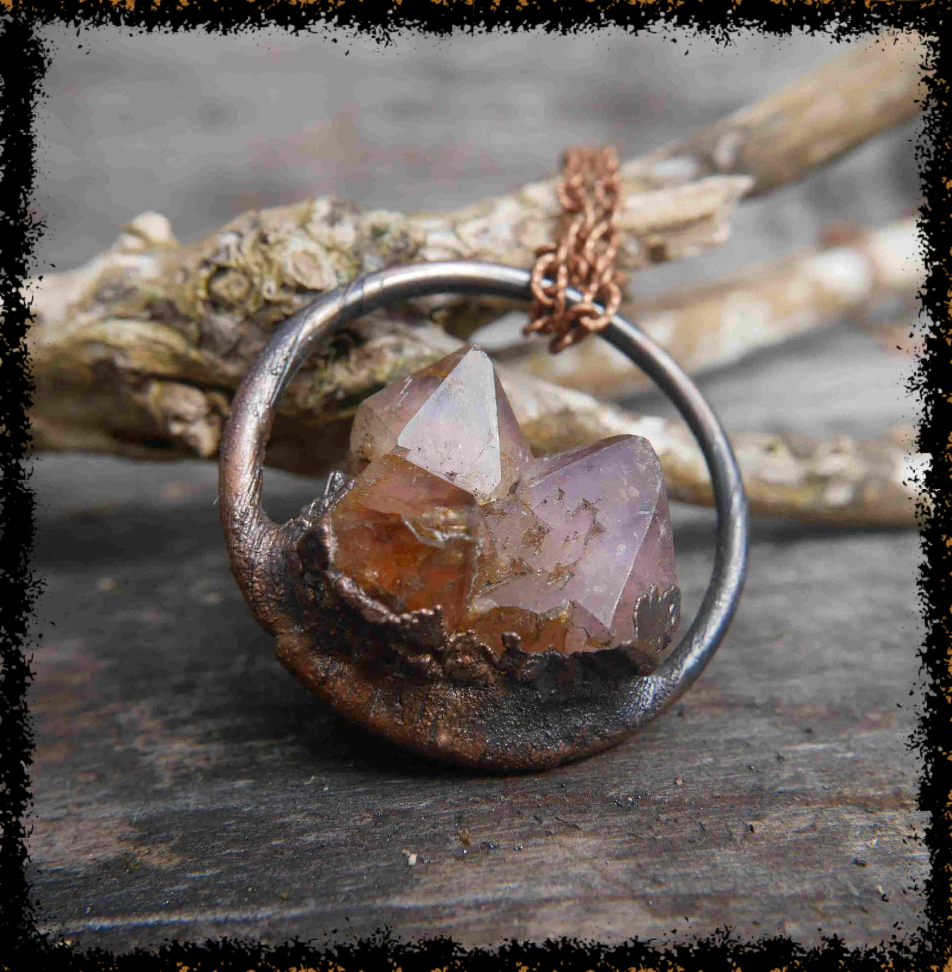 citrine gemstone in copper pendant on chain